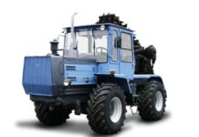 ХТЗ 150К 09 25 с машиной для резки мерзлого грунта МРМГ